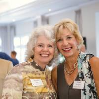 Marcia Haas smiling with guest at Naples 2019